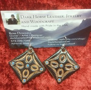 Hand tooled leather earrings.